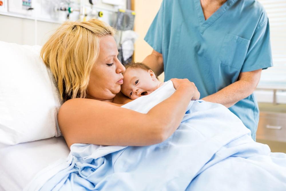 mum holding new baby to chest